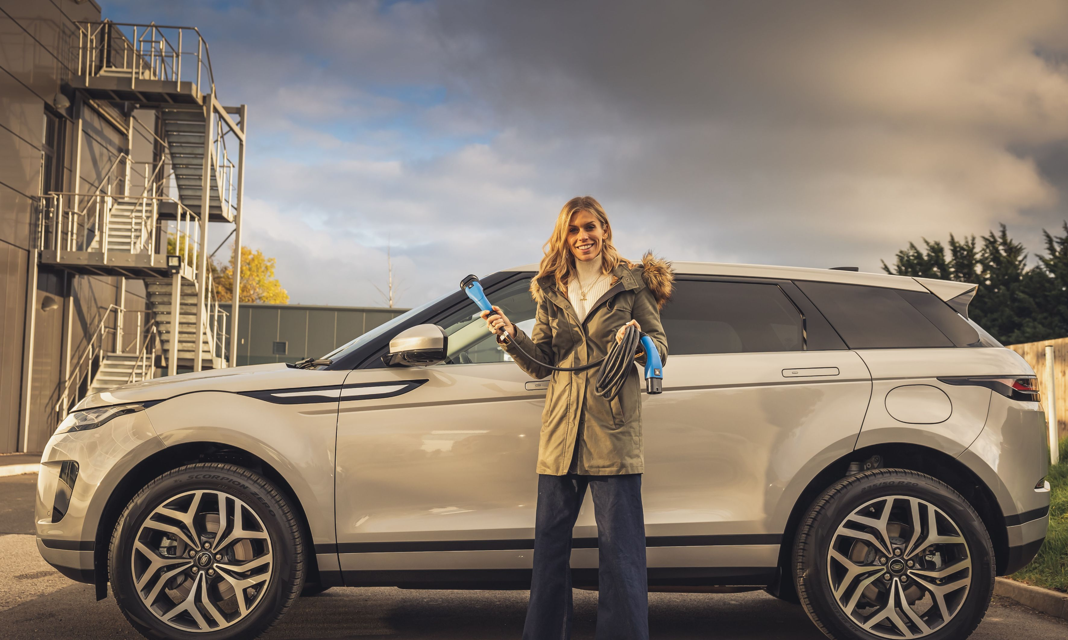 Nicki Shields with electric car and charger